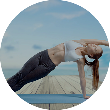 Yoga girl stretching to her left with left hand on yoga mat outside her clean home